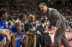 Kentucky head coach John Calipari yells to his bench during the first half of an NCAA college basketball game against Arkansas, Tuesday, Jan. 14, 2014, in Fayetteville, Ark. (AP Photo/Gareth Patterson)