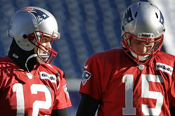 New England Patriots quarterbacks Tom Brady (12) and Ryan Mallett talk as they walk across the field during a stretching and drills session before practice begins at the NFL football team's facility in Foxborough, Mass., Wednesday, Dec. 18, 2013. (AP Photo/Stephan Savoia)
