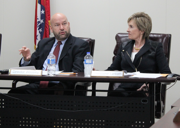 arkansas-scholarship-lottery-director-bishop-woosley-speaks-while-commissioner-dianne-lamberth-looks-on-during-a-meeting-of-the-lottery-commission-wednesday