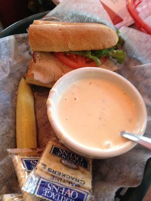The soup (cup of pepper Jack chicken) and half-sandwich (El Diablo) combo saves money at EJ's Eats & Drinks.