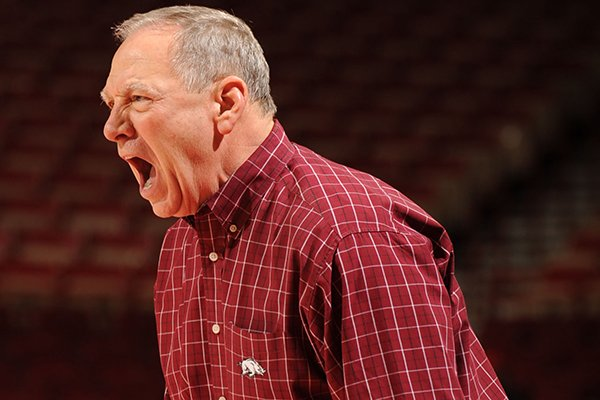 Arkansas coach Tom Collen directs his players during the second half of play against Mississippi State Sunday, Jan. 12, 2014, in Bud Walton Arena in Fayetteville.