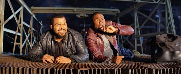 james-ice-cube-is-a-crusty-police-detective-looking-to-scare-security-guard-ben-kevin-hart-away-from-his-sister-in-ride-along