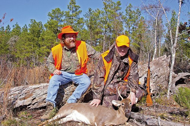 keith-left-and-zach-sutton-of-alexander-pose-for-a-photo-in-2006-after-15-year-old-zach-killed-this-spike-buck-the-father-and-son-have-many-good-memories-of-hunting-together-from-a-friends-deer-stand