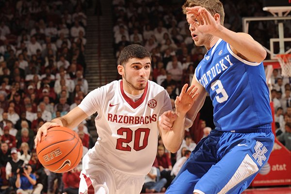 Arkansas guard Kikko Haydar (20) drives as Kentucky guard Jarrod Polson defends during the first half of play Tuesday, Jan. 14, 2014, in Bud Walton Arena in Fayetteville.