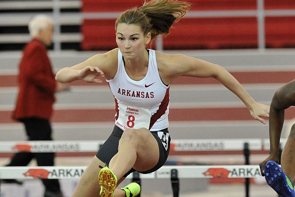 Arkansas hurdler Alex Gochenour clears a hurdle on her way to a 3rd place finish in the women's 60 meter hurdles event at the Arkansas Invitational indoor track meet Friday afternoon at the Randal Tyson Track Complex in Fayetteville.