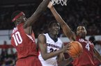 Arkansas forward Bobby Portis (10) and forward Coty Clarke (4) double-team Georgia forward Brandon Morris (31) under the basket during the first half of an NCAA college basketball game Saturday, Jan. 18, 2014, in Athens, Ga. (AP Photo/The Banner-Herald, Richard Hamm)