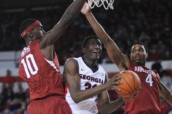 arkansas-forward-bobby-portis-10-and-forward-coty-clarke-4-double-team-georgia-forward-brandon-morris-31-under-the-basket-during-the-first-half-of-an-ncaa-college-basketball-game-saturday-jan-18-2014-in-athens-ga-ap-photothe-banner-herald-richard-hamm