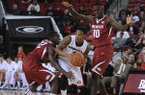 Georgia guard Charles Mann (4) is double-teamed by Arkansas forward Bobby Portis (10) and guard Fred Gulley III (12) during the first half of an NCAA college basketball game Saturday, Jan. 18, 2014, in Athens, Ga. (AP Photo/The Banner-Herald, Richard Hamm)