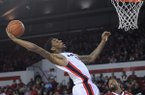 Georgia forward Donte' Williams (15) stretches to grab a rebound during the first half of an NCAA college basketball game against Arkansas Saturday, Jan. 18, 2014, in Athens, Ga. (AP Photo/The Banner-Herald, Richard Hamm)