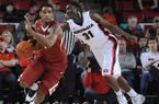 Georgia forward Brandon Morris (31) reaches in to steal from Arkansas forward Coty Clarke (4) during the first half of an NCAA college basketball game Saturday, Jan. 18, 2014, in Athens, Ga. (AP Photo/The Banner-Herald, Richard Hamm)