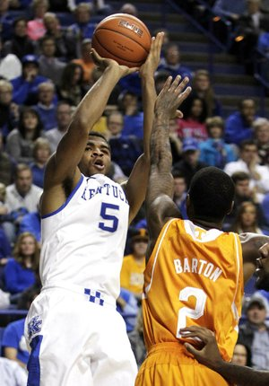 Kentucky's Andrew Harrison (5) shoots under pressure from Tennessee's Antonio Barton (2) during the second half of an NCAA college basketball game, Saturday, Jan. 18, 2014, in Lexington, Ky. Kentucky won 74-66. (AP Photo/James Crisp)