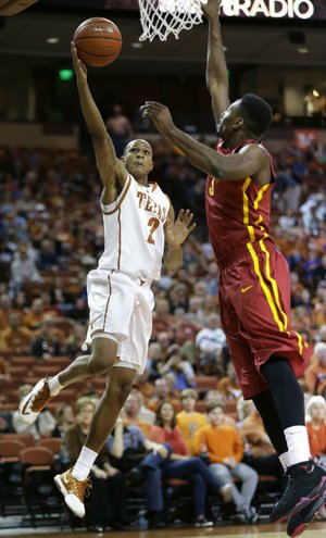 Texas' Demarcus Holland (2) shoots over Iowa State's Melvin Ejim, right, during the first half on an NCAA college basketball game, Saturday,  Jan. 18, 2014, in Austin, Texas. (AP Photo/Eric Gay)