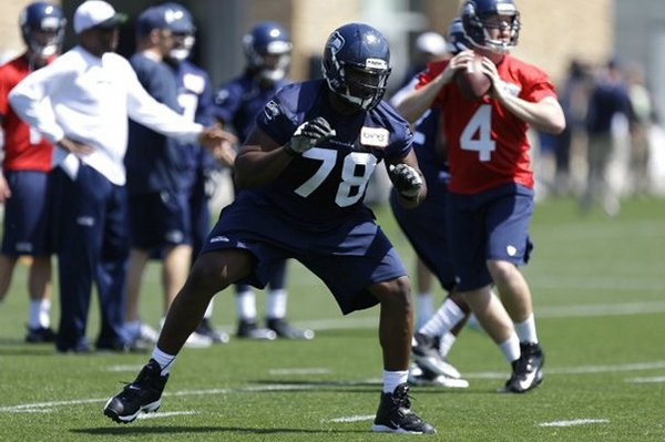 Seattle Seahawks Alvin Bailey (78) blocks as quarterback Casey Brockman (4) looks to pass during practice drills at Seahawks NFL football Rookie Minicamp, Friday, May 10, 2013, in Renton, Wash. (AP Photo/Ted S. Warren)