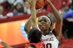 Arkansas forward Jessica Jackson pulls up to hit a jump shot over Ole Miss defender Valencia McFarland at the buzzer before halftime during Sunday afternoon's game at Bud Walton Arena in Fayetteville.