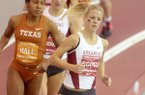 Arkansas junior Dominique Scott leads the pack around a turn in the women's mile during a dual meet against Texas on Friday, Jan. 17, 2014, at the Randal Tyson Track Center in Fayetteville.
