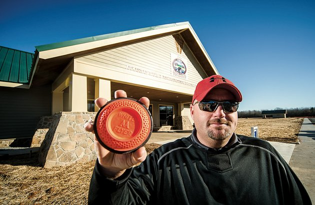 kevin-house-jacksonville-parks-and-recreation-director-holds-a-clay-pigeon-in-front-of-the-new-arkansas-game-and-fish-foundation-shooting-sports-complex