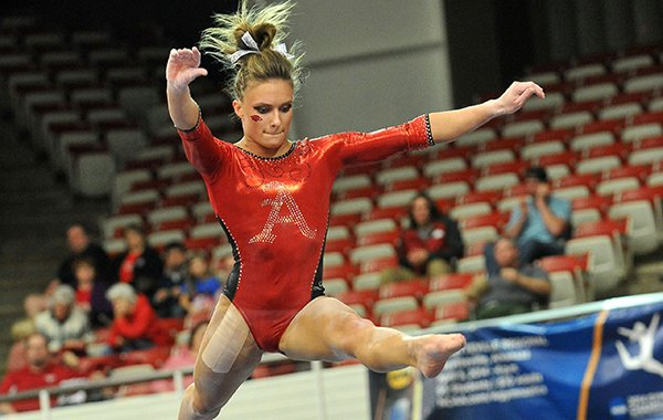 Arkansas gymnast Katherine Grable performs on the beam during a Jan. 10, 2014 gymnastics meet at Barnhill Arena in Fayetteville.