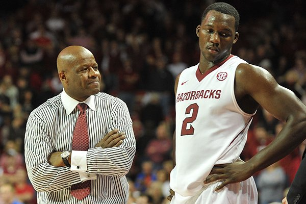 Arkansas coach Mike Anderson and Arkansas forward Alandise Harris talk on the sidelines after Arkansas turned the ball over late in the overtime period of a game against Florida at Bud Walton Arena in Fayetteville.
