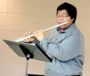 Photo by Mike Eckels Ger Vang, senior high school band student seen here in concert during the Decatur Christmas Festival in December, won first chair, first band, in the flute during all-region band tryouts. Vang will audition for the all-state band competition on Feb. 8 at ASU in Jonesboro.