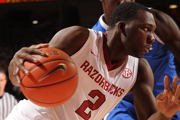 Arkansas forward Alandise Harris (2) drives to the basket past Kentucky forward Julius Randle during the first half of play Tuesday, Jan. 14, 2014, in Bud Walton Arena in Fayetteville.
