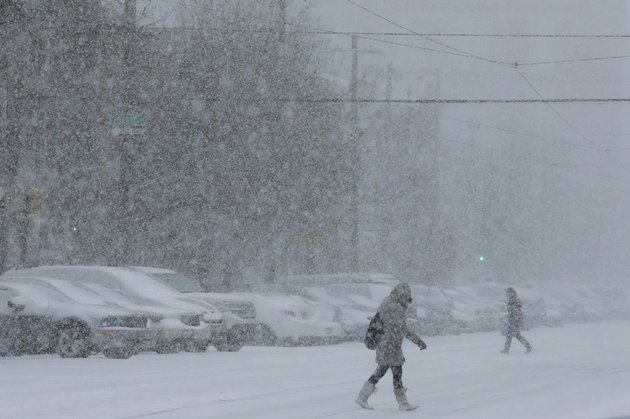 pedestrians-walk-through-a-snowstorm-tuesday-jan-21-2014-in-south-philadelphia-a-storm-is-sweeping-across-the-mid-atlantic-and-new-england-the-national-weather-service-said-the-storm-could-bring-8-to-12-inches-of-snow-to-philadelphia-and-new-york-city-and-more-than-a-foot-in-boston