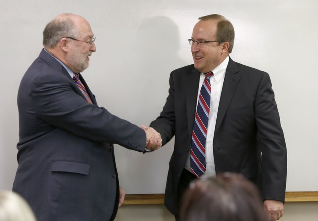 jeff-jeffus-left-president-of-wehco-newspapers-congratulates-todd-nelson-right-following-his-introduction-as-the-new-president-of-northwest-arkansas-newspapers-and-vice-president-and-general-manager-of-the-northwest-edition-of-the-arkansas-democrat-gazette-tuesday-morning-at-the-northwest-arkansas-times-office-building-in-fayetteville