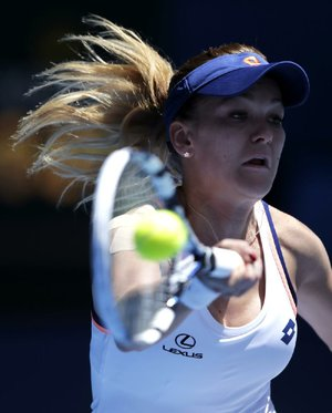 Agnieszka Radwanska upset Victoria Azarenka 6-1, 5-7, 6-0 in a women's quarterfinal match at the Australian Open.