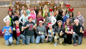 Photo by Randy Moll In addition to presenting a Christmas musical, Gentry Middle and High School choir members collected 356 cans of food for the local food pantry managed by the First Christian Church in Gentry.