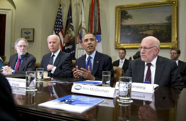 president-barack-obama-speaks-to-media-as-he-meets-with-from-left-robert-bauer-co-chair-presidential-commission-on-election-administration-vice-president-joe-biden-and-benjamin-ginsberg-co-chair-presidential-commission-on-election-administration-and-other-members-of-the-presidential-commission-on-election-administration-wednesday-jan-22-2014-in-the-roosevelt-room-of-the-white-house-in-washington-the-commission-was-created-to-identify-non-partisan-ways-to-shorten-lines-at-polling-places-promote-the-efficient-conduct-of-elections-and-provide-better-access-to-the-polls-for-all-voters