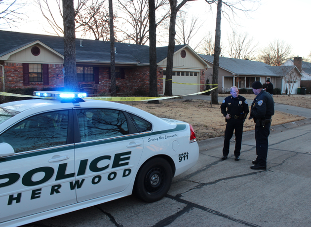 sherwood-police-work-the-scene-of-a-domestic-disturbance-where-officers-shot-a-man-who-was-armed-with-two-handguns-authorities-said