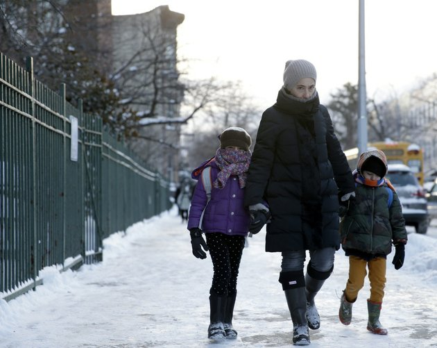 parents-and-children-arrive-to-school-bundled-up-against-the-cold-in-the-brooklyn-borough-of-new-york-on-wednesday-jan-22-2014-a-winter-storm-stretched-from-kentucky-to-new-england-and-hit-hardest-along-the-heavily-populated-interstate-95-corridor-between-philadelphia-and-boston