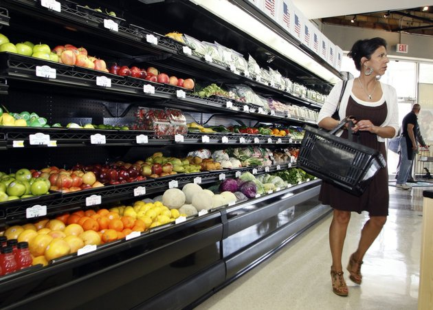 shopper-connie-walker-works-her-way-through-the-produce-section-while-shopping-at-the-argenta-market-grocery-store-in-north-little-rock-on-april-15-2010