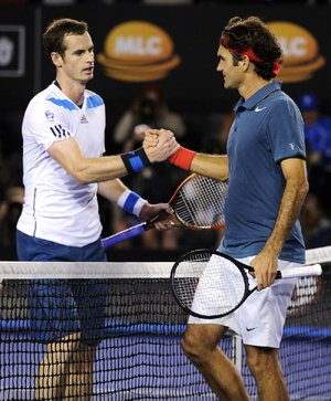 Roger Federer of Switzerland (right) shakes hands with Britain's Andy Murray at the net following Federer's 6-3, 6-4, 6-7 (6), 6-3 quarterfinal victory over Murray at the Australian Open in Melbourne, Australia. Federer advances to face top-seeded Rafael Nadal in the semifinals.