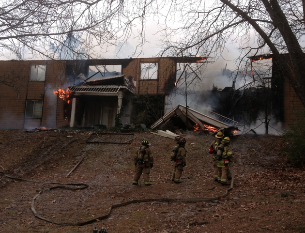 a-fire-burns-at-the-out-in-the-woods-apartments-on-kanis-road-in-little-rock-on-thursday-jan-23-2014