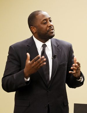 Dr. Calvin White, Jr., director of the African and African American Studies program at the University of Arkansas, gives a presentation titled 'Was it All a Dream?: Martin Luther King, Jr.'s Vision Today' on Thursday January 23, 2014 in the Becky Paneitz Student Center at Northwest Arkansas Community College in Bentonville.