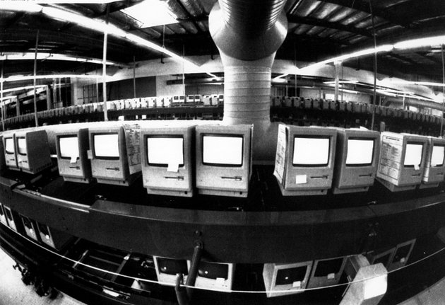 in-this-march-28-1984-file-photo-thousands-of-apple-macintosh-computers-sit-on-double-decked-manufacturing-lines-friday-january-24-2014-marks-thirty-years-after-the-first-mac-computer-was-introduced-sparking-a-revolution-in-computing-and-in-publishing-as-people-began-creating-fancy-newsletters-brochures-and-other-publications-from-their-desktops