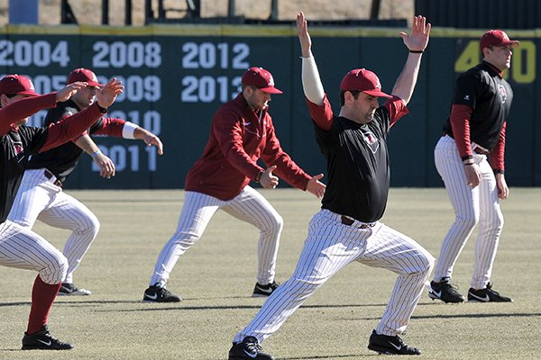 Arkansas catcher Jake Wise warm ups before the start of the Razorbacks first practice of the season Friday afternoon at Baum Stadium in Fayetteville.