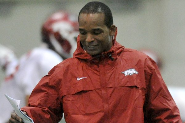 Arkansas linebackers coach Randy Shannon works during a spring practice in Fayetteville.