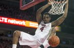 Arkansas guard Coty Clarke (4) dunks the ball during the second half of an NCAA college basketball game against Auburn on Saturday, Jan. 25, 2014, in Fayetteville, Ark.. Arkansas defeated Auburn 86-67. (AP Photo/Gareth Patterson)