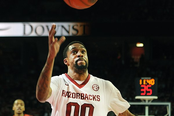 Arkansas' Rashad Madden chases the ball down court to save it Saturday, Jan. 25, 2014, during the second half of the game against Auburn at Bud Walton Arena in Fayetteville.
