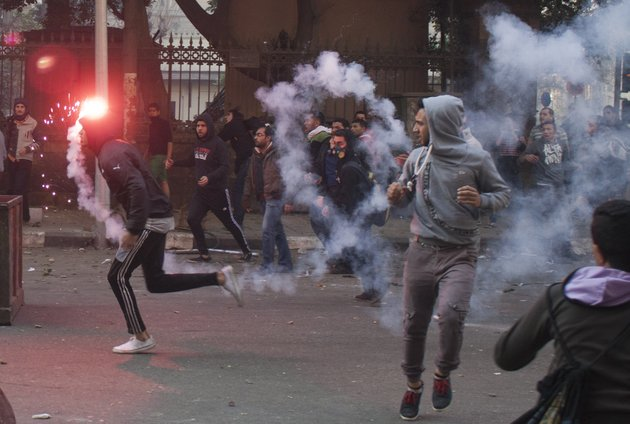 egyptian-anti-military-protesters-mostly-supporters-of-ousted-islamist-president-mohammed-morsi-clash-with-security-forces-in-downtown-cairo-egypt-saturday-jan-25-2014-security-forces-also-moved-to-shut-down-rallies-marking-the-anniversary-by-secular-youth-activists-who-led-the-2011-anti-mubarak-uprising-and-who-are-critical-of-both-the-islamists-and-the-military-a-number-of-their-most-prominent-figures-have-been-in-prison-for-months-amid-a-campaign-to-silence-even-secular-voices-of-dissent-ap-photoahmed-ashraf