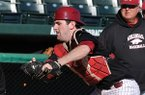 Arkansas Jake Wise puts the tag on baserunner Carson Shaddy as the Razorbacks run situation drills during the first practice of the season Friday afternoon at Baum Stadium in Fayetteville.
