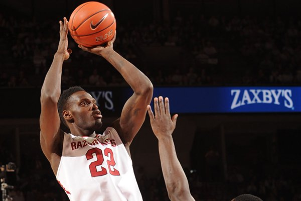 Arkansas forward Jacorey Williams (22) takes a shot over Kentucky forward Julius Randle during the first half of play Tuesday, Jan. 14, 2014, in Bud Walton Arena in Fayetteville.
