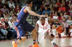 Arkansas' Fred Gulley gets low to regain balance after fighting with Auburn's Tahj Shamsid-Deen for a ball loose in the air Saturday, Jan. 25, 2014, during the second half of the game against Auburn at Bud Walton Arena in Fayetteville.