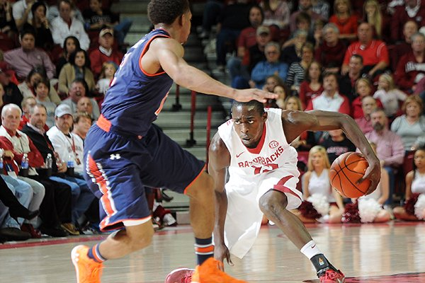 arkansas-fred-gulley-gets-low-to-regain-balance-after-fighting-with-auburns-tahj-shamsid-deen-for-a-ball-loose-in-the-air-saturday-jan-25-2014-during-the-second-half-of-the-game-against-auburn-at-bud-walton-arena-in-fayetteville