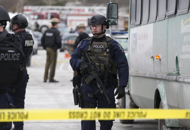 a-heavily-armed-police-officer-walks-on-scene-after-a-shooting-at-the-mall-in-columbia-on-saturday-jan-25-2014-in-columbia-md-police-say-three-people-died-in-a-shooting-at-the-mall-in-suburban-baltimore-including-the-presumed-gunman-ap-photo-evan-vucci