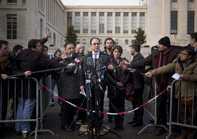 monzer-akbik-center-a-spokesman-of-the-syrian-national-coalition-syrias-main-political-opposition-group-is-surrounded-by-journalists-after-a-meeting-with-the-syrian-government-at-the-united-nations-headquarters-in-geneva-switzerland-sunday-jan-26-2014-syrians-on-opposite-sides-of-their-countrys-civil-war-tried-again-sunday-to-find-common-ground-with-peace-talks-focusing-on-an-aid-convoy-to-a-besieged-city-that-once-more-came-under-mortar-attack-from-the-government-ap-photoanja-niedringhaus