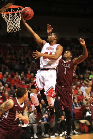 Arkansas State's Ed Townsel drives past UALR's Leroy Isler in the first half of the Red Wolves' 77-49 victory in Jonesboro on Saturday. Townsel had nine points and nine rebounds in the game.