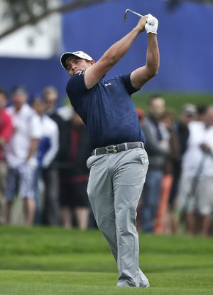 Scott Stallings follows through after a shot on the 18th hole of the South Course at Torrey Pines during the final round of the Farmers Insurance Open golf tournament, Sunday, Jan. 26, 2014, in San Diego. Stallings won the tournament. (AP Photo/Lenny Ignelzi)