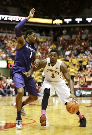 Iowa State forward Melvin Ejim (3) drives to the basket past Kansas State guard Shane Southwell during the second half of the No. 16 Cyclones' 81-75 victory over the No. 22 Wildcats on Saturday at Hilton Coliseum in Ames, Iowa. Ejim scored 20 points to lead the Cyclones, who broke a three-game losing streak.
